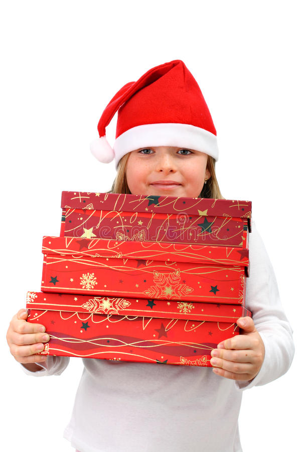 przewożenia dziewczyny kapelusz przedstawia s Santa mali trzy fotografia stock