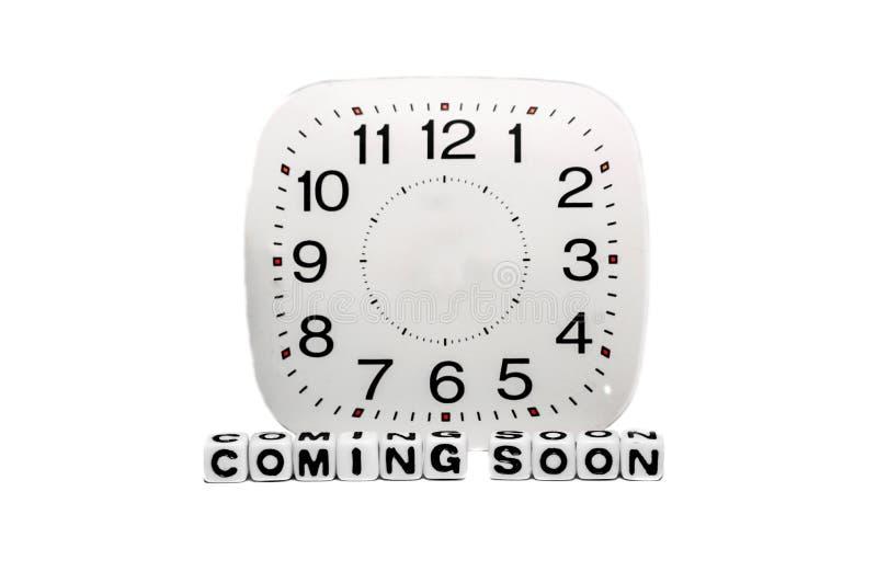 Przychodzić wkrótce z pełnym zegarem obrazy royalty free