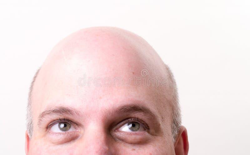 przyglądający łysy przyglądający mężczyzna obrazy royalty free