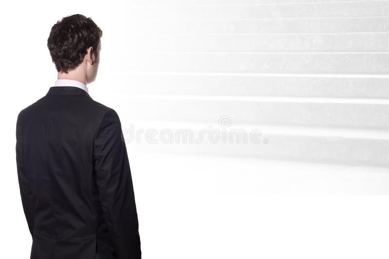 przyglądający biznesmenów schodki obraz royalty free