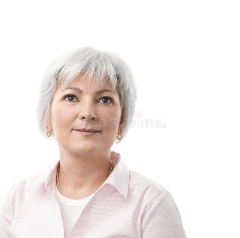 Starszej kobiety Przyglądający up fotografia royalty free