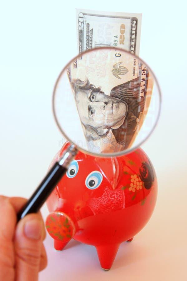 przyglądający pieniądze fotografia stock
