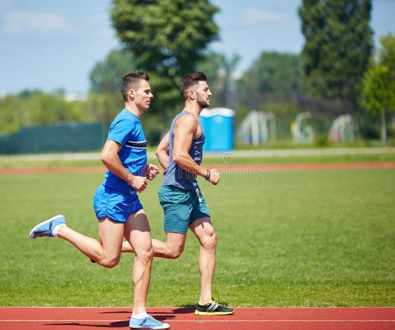 Przyjaciół biegać zdjęcie stock