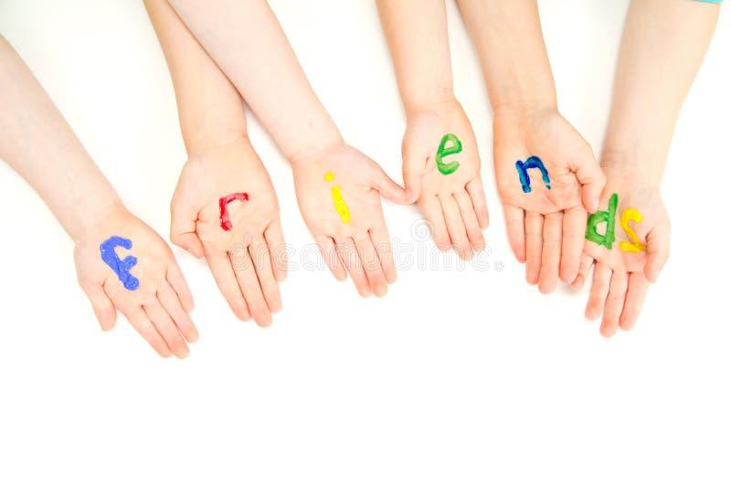 Przyjaciele żartują ręk palmy w kolorowym farba znaku obraz royalty free