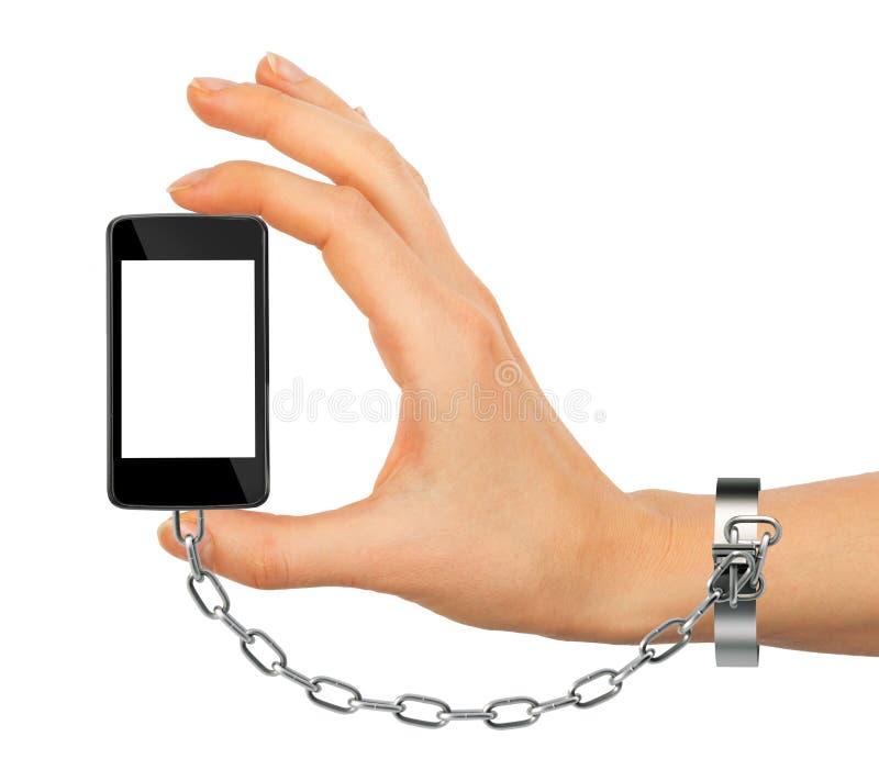Przykuwający żeński ręki mienia telefon fotografia royalty free