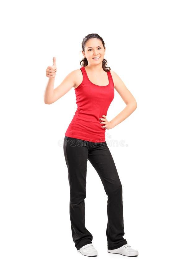 Przypadkowa dziewczyna daje kciukowi up zdjęcie stock
