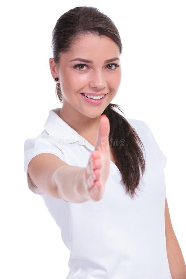 Przypadkowa kobieta oferuje uścisk dłoni obrazy royalty free