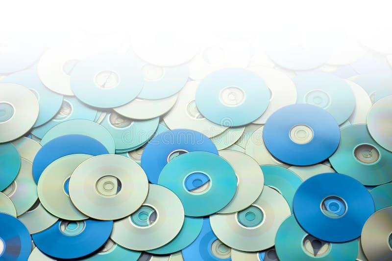 Przypadkowy przygotowania srebni błękitnego popielatego DVD i cd dane magazynu dyski fotografia royalty free