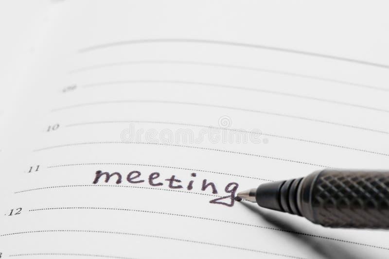 Przypomnienie w notatniku znacząco spotkanie zdjęcie royalty free