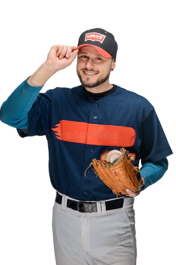 Przystojny gracz baseballa na bielu zdjęcie stock