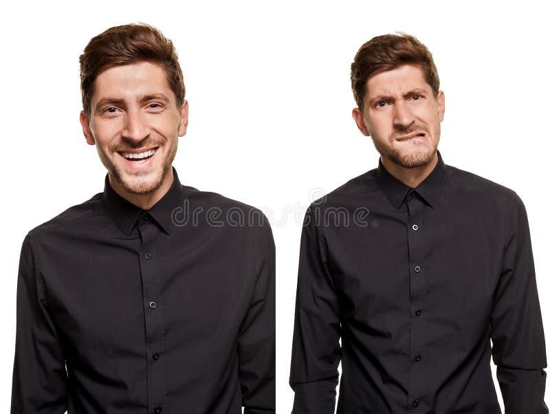 Przystojny mężczyzna w czarnej koszula robi twarzom, stoi przeciw białemu tłu fotografia stock