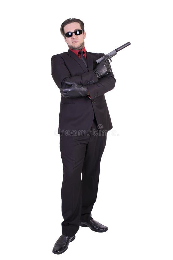 Przystojny mężczyzna mienia pistolet obraz royalty free