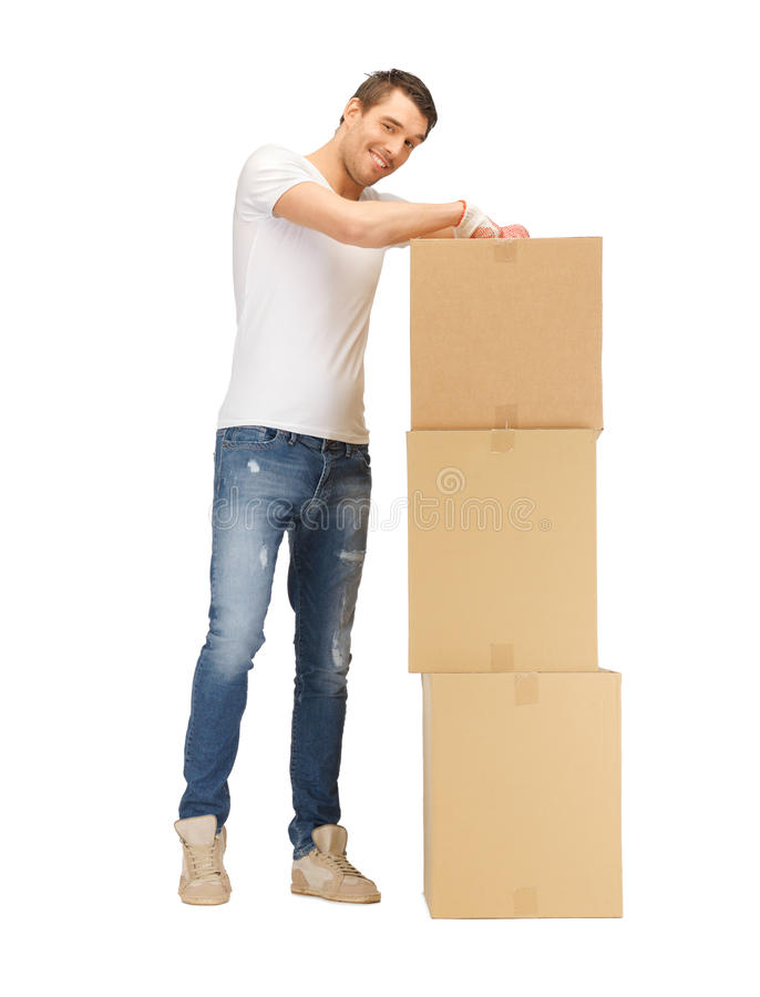 Przystojny mężczyzna z dużymi pudełkami zdjęcie royalty free