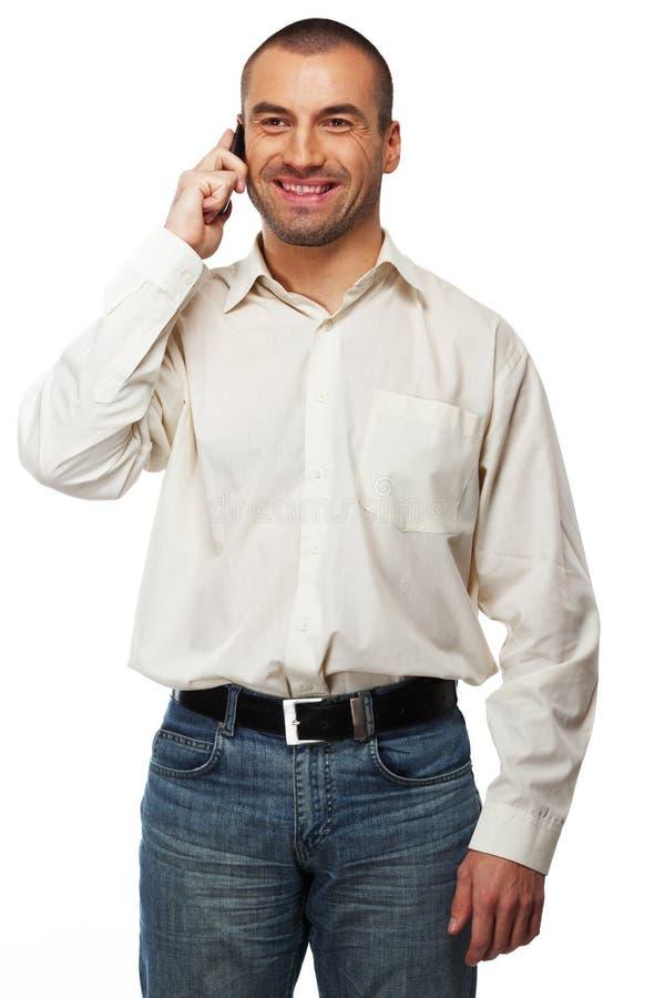 Przystojny mężczyzna z telefonem komórkowym zdjęcie stock