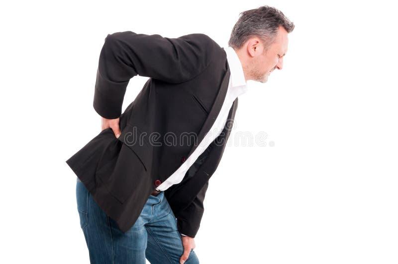 Przystojny młodego człowieka cierpienie od backache zdjęcie royalty free
