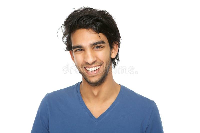 Przystojny młody indyjski mężczyzna ono uśmiecha się zdjęcie stock
