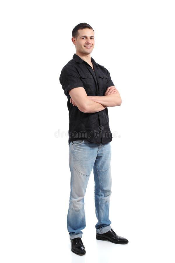 Przystojny szczęśliwy pozycja mężczyzna promuje i przedstawia obrazy stock