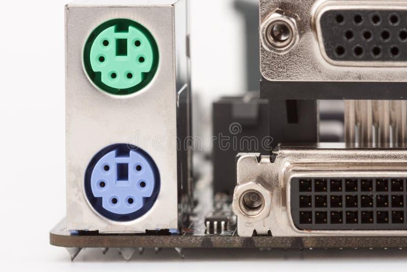 PS/2 gör grön musport och purpurfärgad port för tangentbord PS/2 på motherbo royaltyfria foton