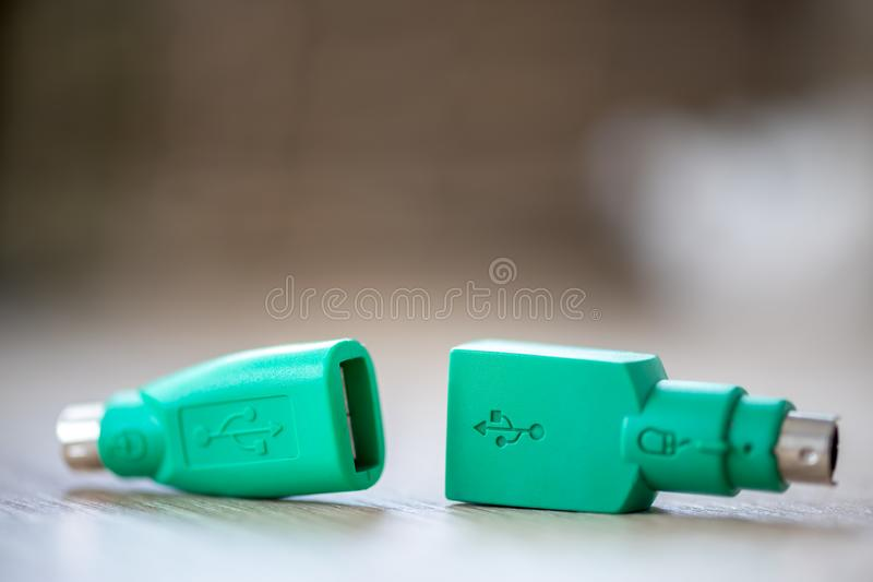 PS2 to USB converter. Close-up of a PS2 to USB converter on a wooden table royalty free stock photography
