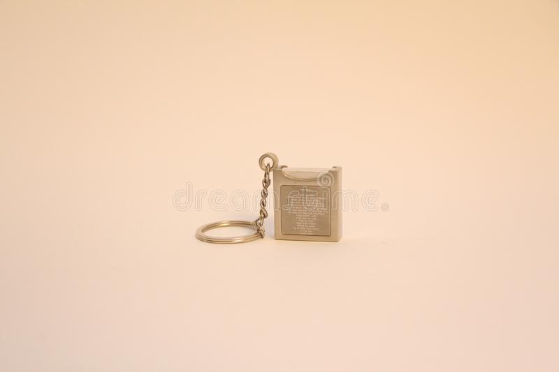 Psalms key holder. Isolated key holder contain inside a little Psalms book stock photos