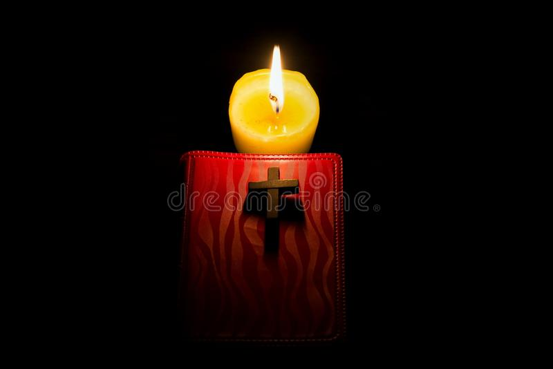 The psalms . small red Bible. Burning candle and Bible . The psalms . Holy book  .  told in the Bible`s New Testament royalty free stock photo