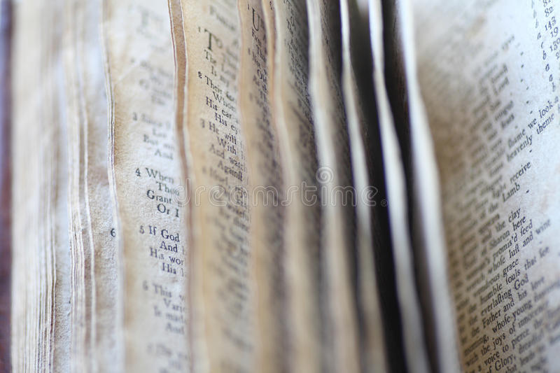 Psalms in vintage book. Closeup view of pages in a 19th century book of Psalms royalty free stock photography