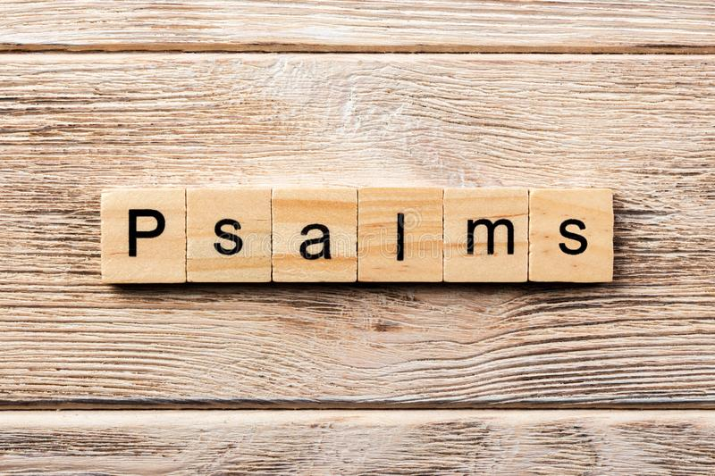 Psalms word written on wood block. psalms text on table, concept.  royalty free stock images