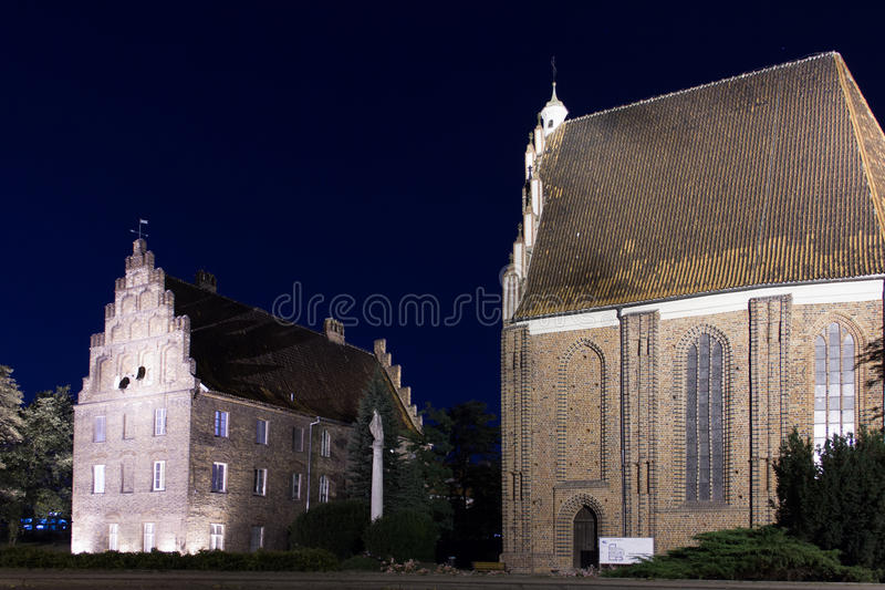 The Psalteria & the Collegiate church of Virgin Mary. Poznan. Poland. Medieval buildings. The Psalteria & the Collegiate church of the holy Virgin Mary at night royalty free stock photography