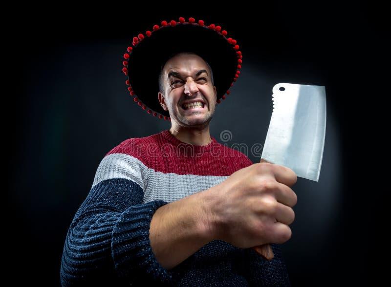 Psico uomo con la mannaia di carne fotografie stock