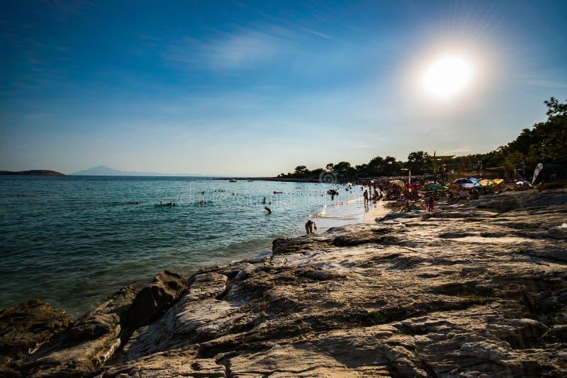 Psili Ammos beach on Greek island Thassos. Panorama of Psili Ammos beach on Thassos island, Greece, Aegean sea stock photo