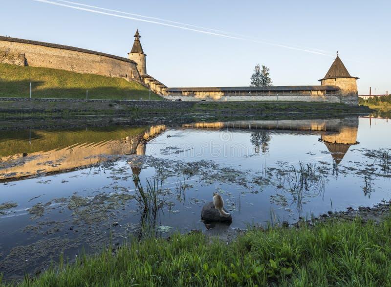 Pskov Kremlin from the side of the Pskova river at sunrise. royalty free stock image