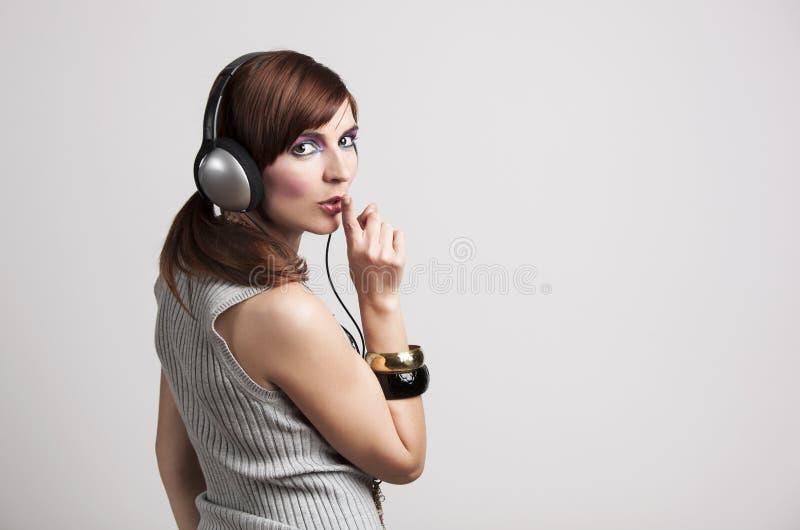 Download Psssssst, I'm listen music stock photo. Image of vivid - 25804244