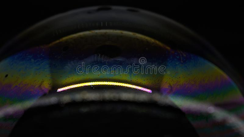 Psychedelic abstract formed by light interference on the surface of a soap bubble. Use as a background or wallpaper stock photography