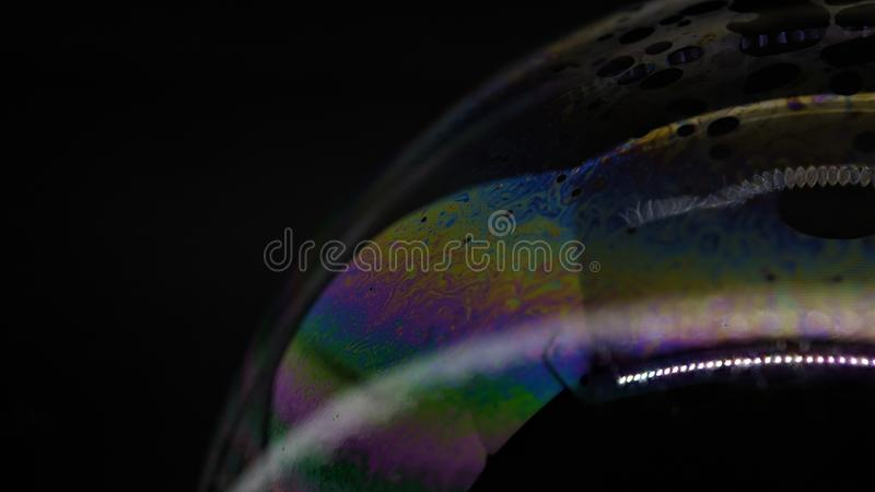 Psychedelic abstract formed by light interference on the surface of a soap bubble. Use as a background or wallpaper stock image