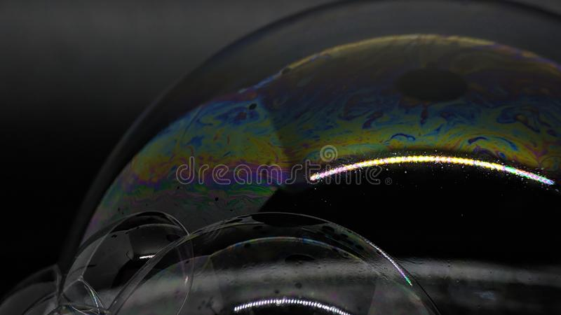 Psychedelic abstract formed by light interference on the surface of a soap bubble. Use as a background or wallpaper stock images