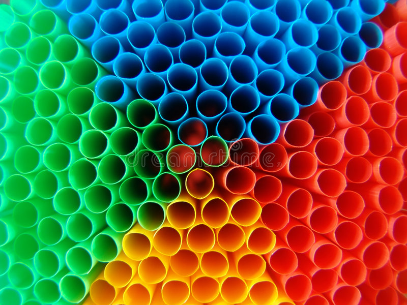 Psychedelic straws. Macro of red, yellow, green and blue straws stock photography