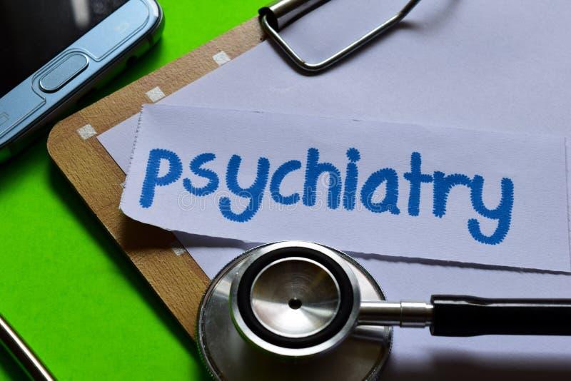 Psychiatrie op Gezondheidszorgconcept met groene achtergrond royalty-vrije stock foto