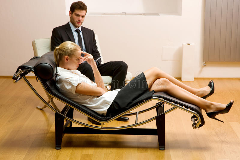 Psychiatrist examining a female patient stock photography