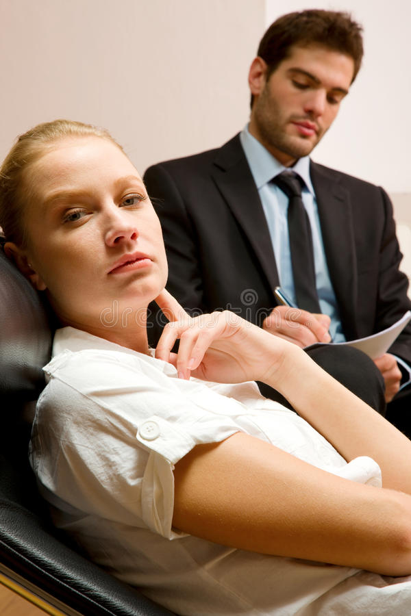 Psychiatrist examining a female patient. At studio royalty free stock images