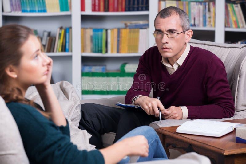 Psychiatrist examining a female patient royalty free stock photos