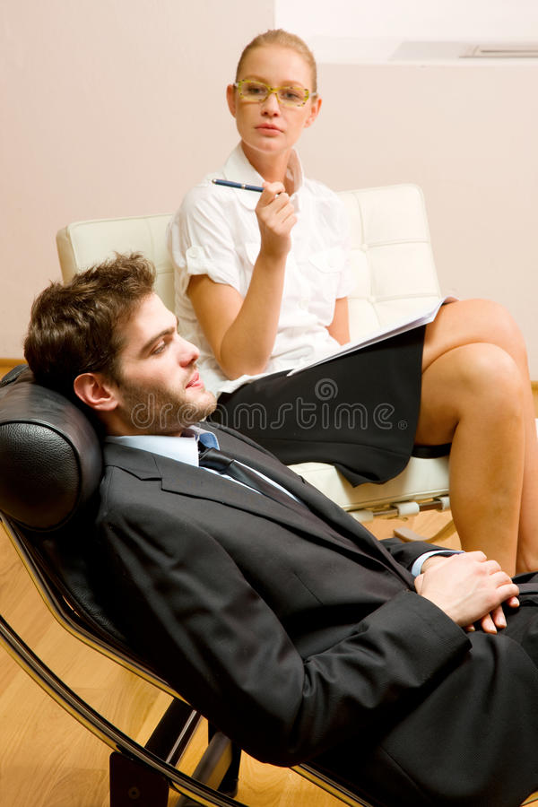 Psychiatrist examining a male patient royalty free stock photos