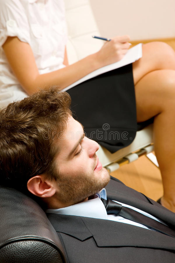 Psychiatrist examining a male patient stock photos