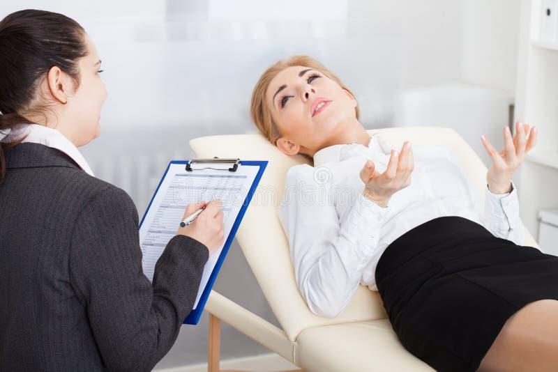 Psychiatrist examining patient royalty free stock photos