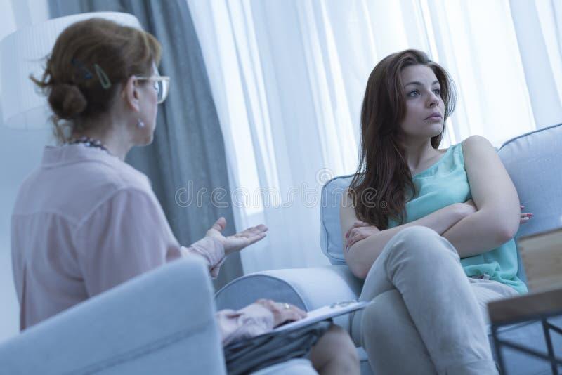 Psychiatrist explaining something to the patient stock photo