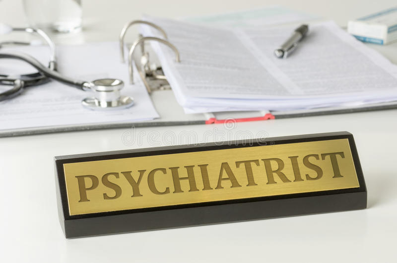 Psychiatrist. Name plate on a desk with the engraving Psychiatrist stock photo
