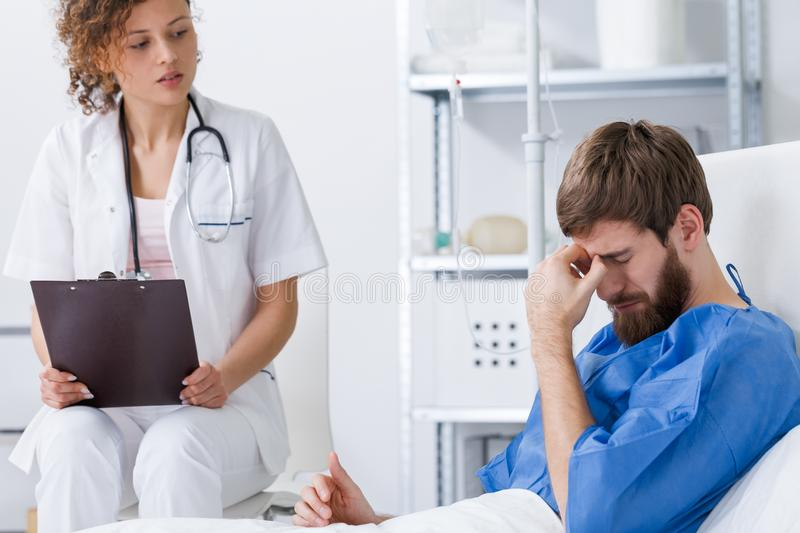 Psychiatrist supporting depressed patient royalty free stock photography