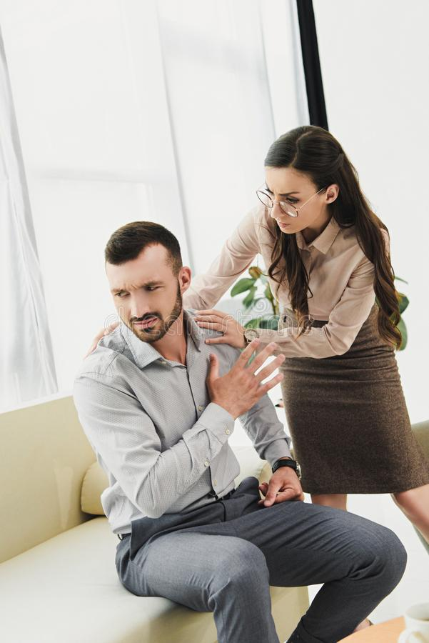 psychiatrist talking to depressed male patient stock photography