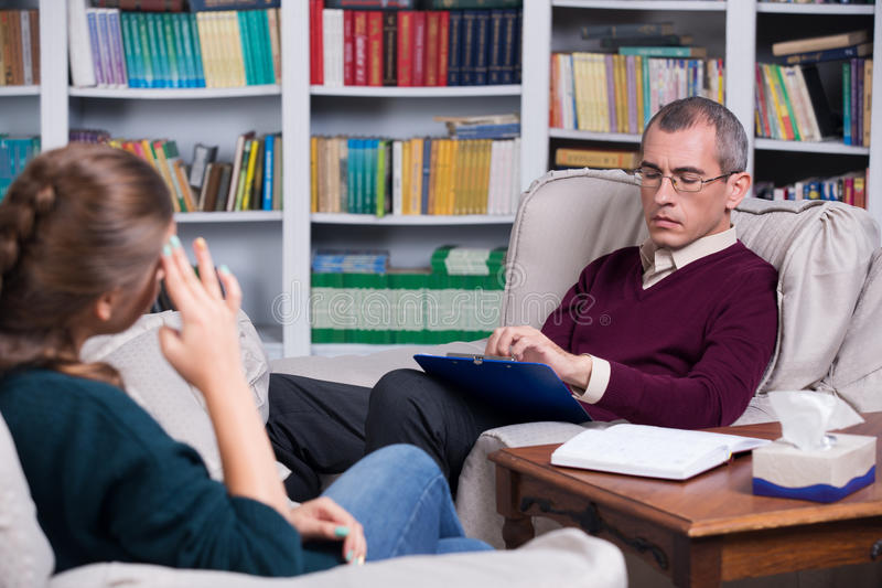 Psychiatrist and woman patient stock image