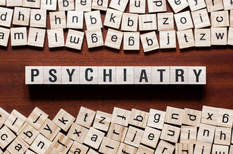 Psychiatry word concept on cubes stock photography
