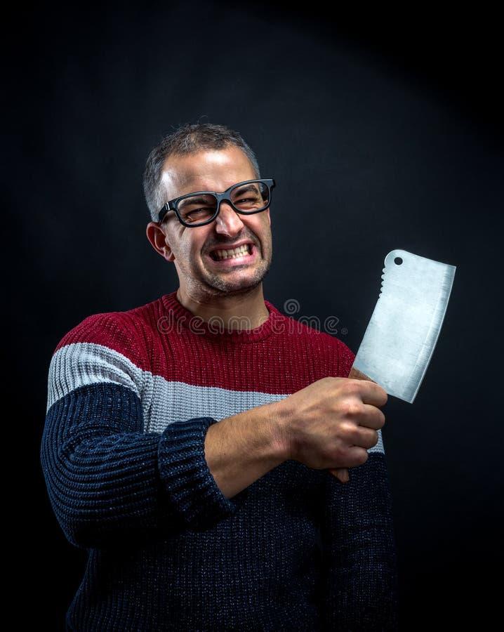 Psychiczny mężczyzna z mięsnym cleaver zdjęcie stock